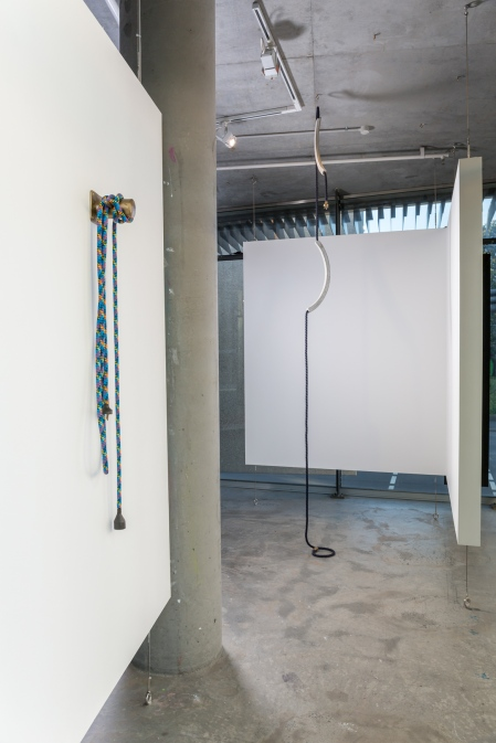 (left) Deb Mansfield, The main persuasion is from one friend to another, bronze cleat, multi-coloured marine rope, bronze electrics, 200mm deep x 1090mm x 200mm, 2016. (right) Deb Mansfield, Increasing levels of collective denial until it's all over, concrete parts, navy marine rope, bronze electrics, dimensions variable, 2016. Image by Document Photography.