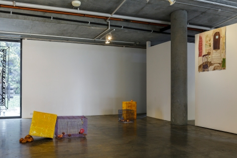 Turtle Dove // (L) Dominic Sargent, Untitled 2017, Cages, packing tape, styrofoam, cardboard, potatoes, onions, orange, birdfeed, hamster wheel, water dispenser, mirror, and plastic toys, Dimensions variable. (R) Dominic Sargent, Houses Architects Live In, 2017, Acrylic on unprimed canvas, 113 x 87 cm. Image by Document Photography.